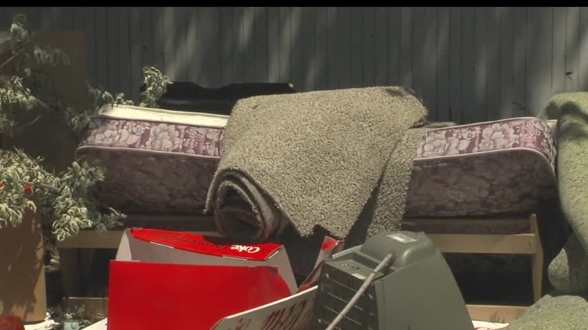 Trash pile problem in Salt Lake City_20160616002504