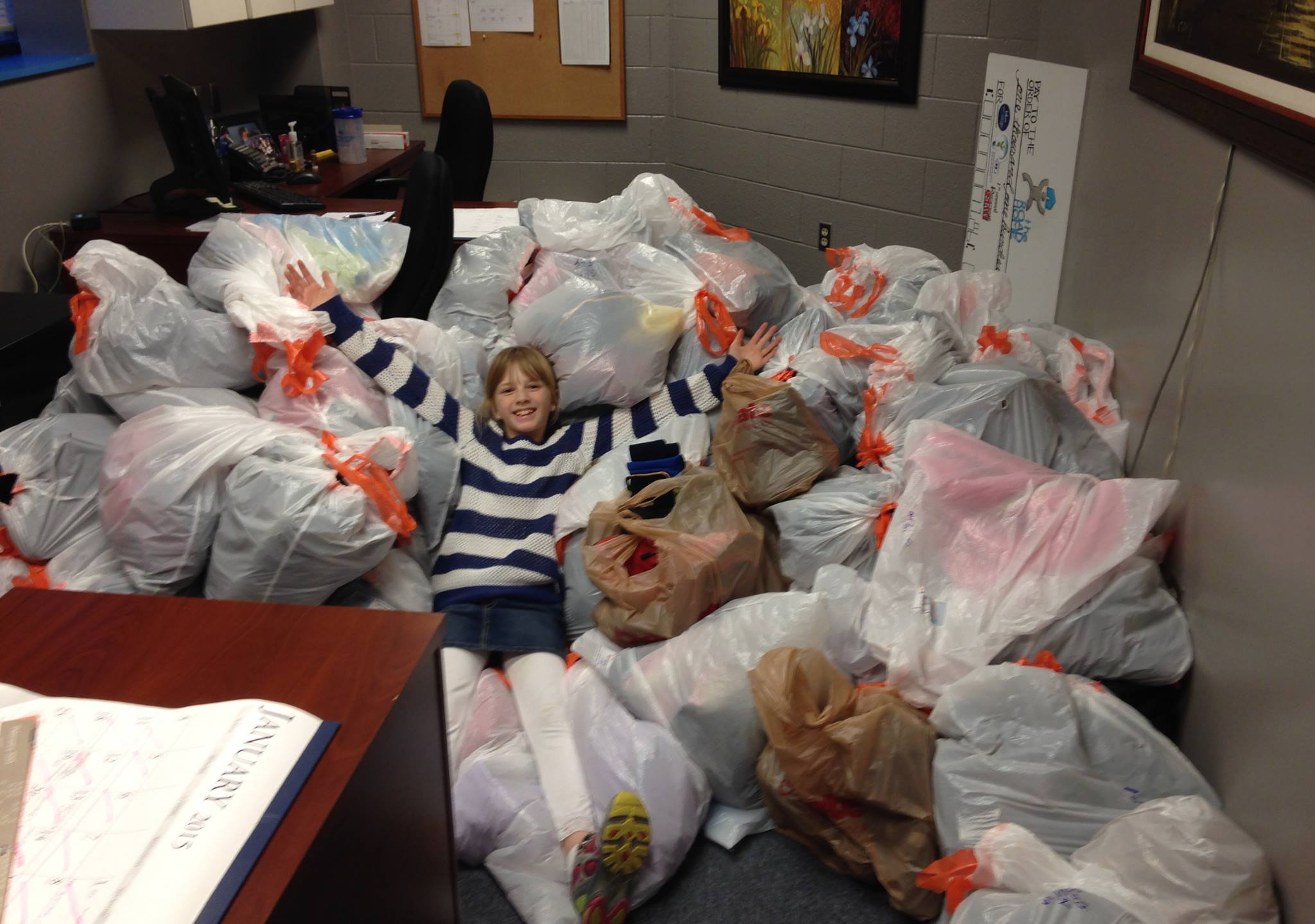 Alia Leonard Donating Backpacks and Gifts to Children