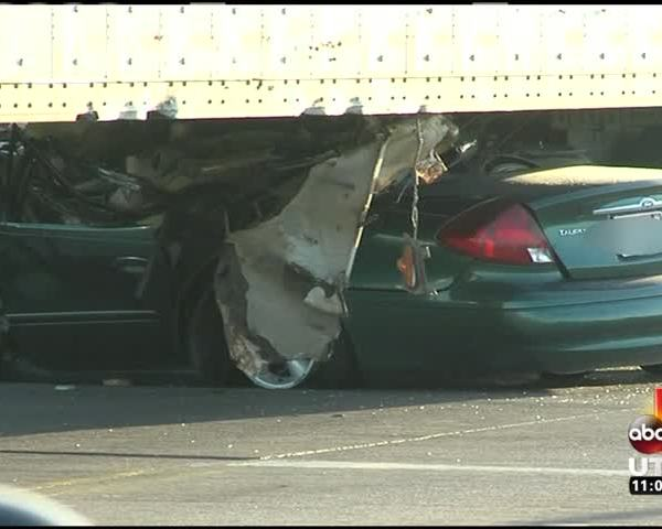 One Man Dead After Car Is Pinned Under Semi Truck_95656504