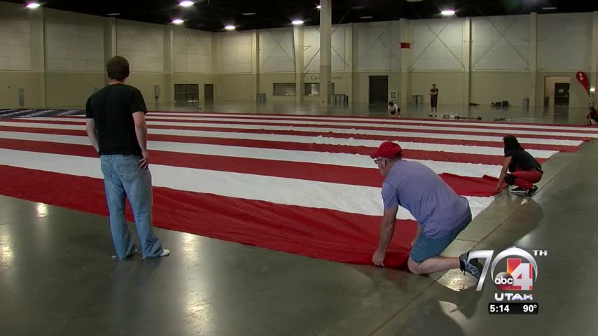 Colonial Flag working on largest American Flag ever flown_12182033