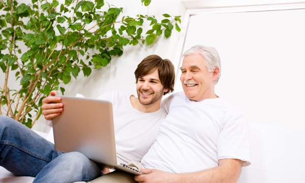 father and son using laptop computer74628368-159532