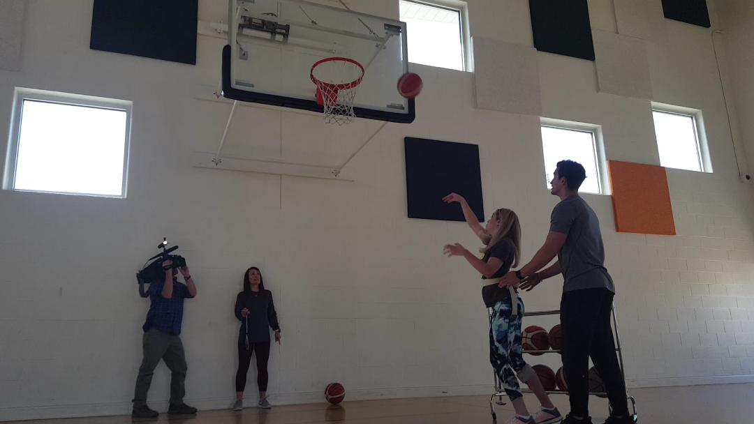 Kendal shooting a basketball as part of her rehab at Neuroworx_1509415845777.jpg