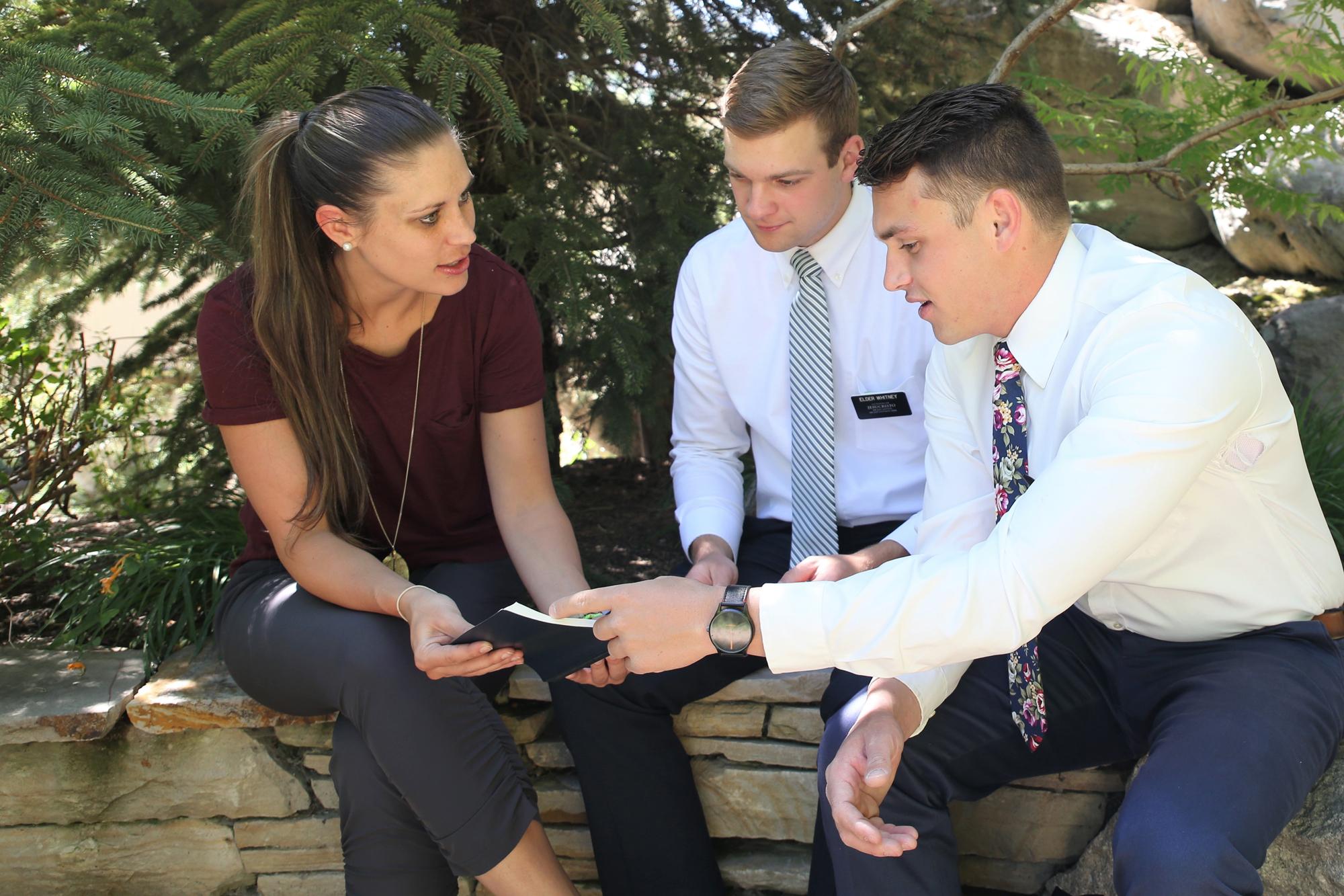 mormon-missionaries-teaching-woman_1508513528164.jpg