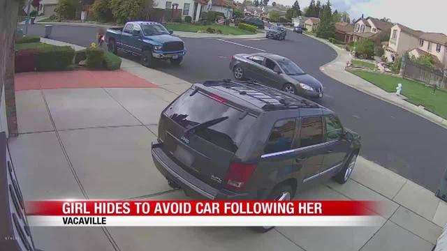 Girl_hides_to_avoid_car__1556204679111.jpg