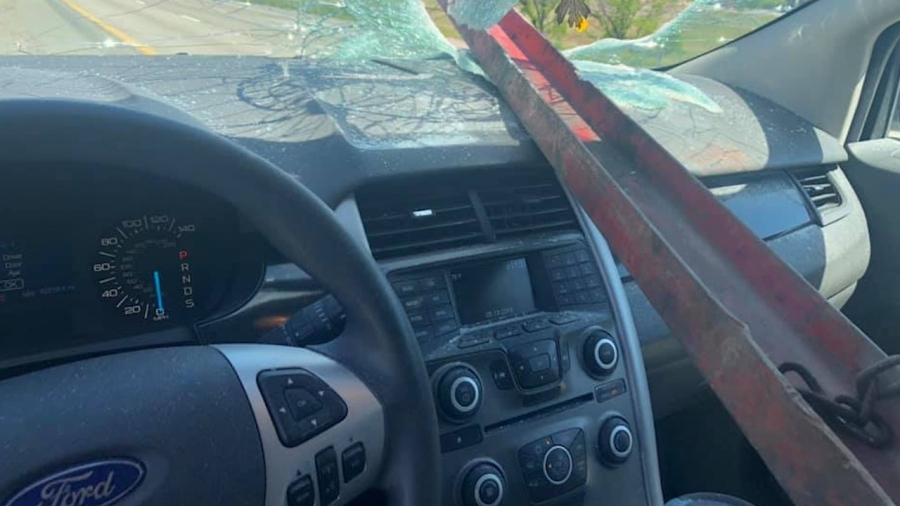 steel beam hits car and goes through windshield into woman's front seat