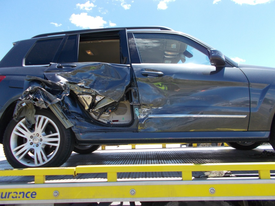 Car damaged in crash caused by unsecured mattress