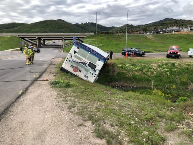 BUS FLIPS INTO DITCH IN SUMMIT COUNTY