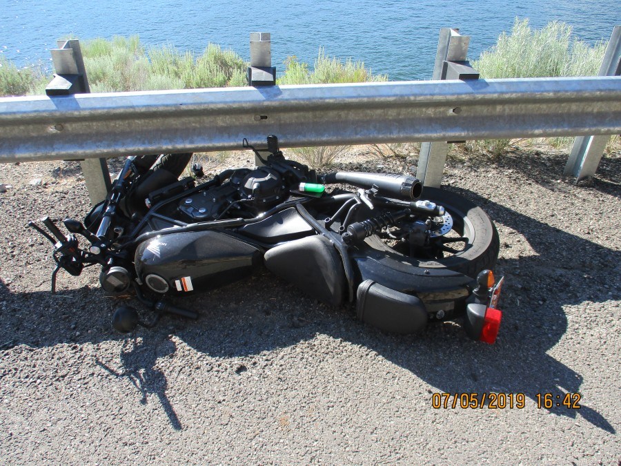 Motorcycle damaged after rider lost control and hit guardrail
