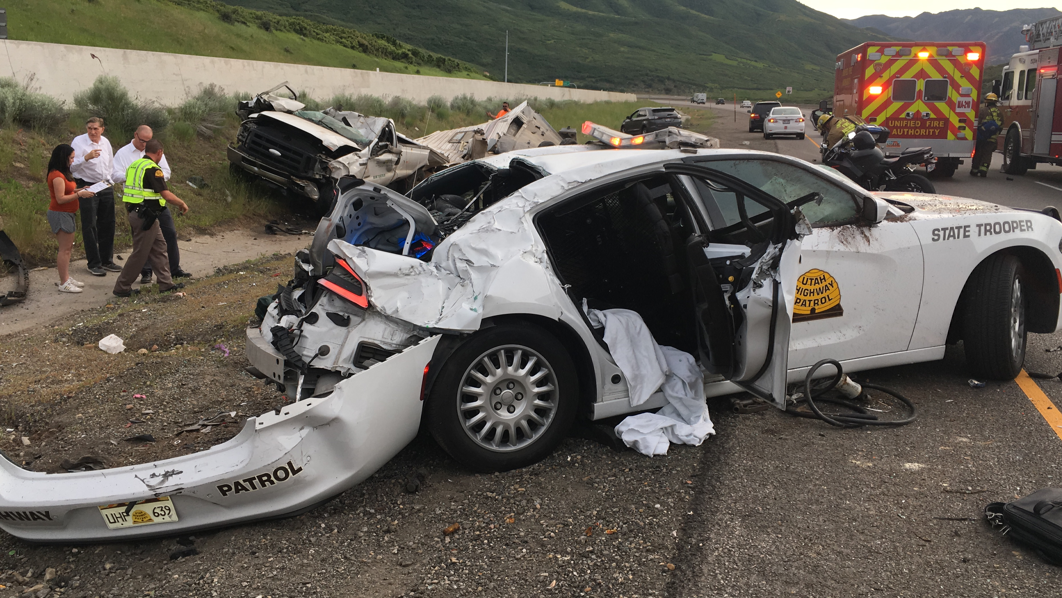 Three people injured when truck barrels over top of UHP