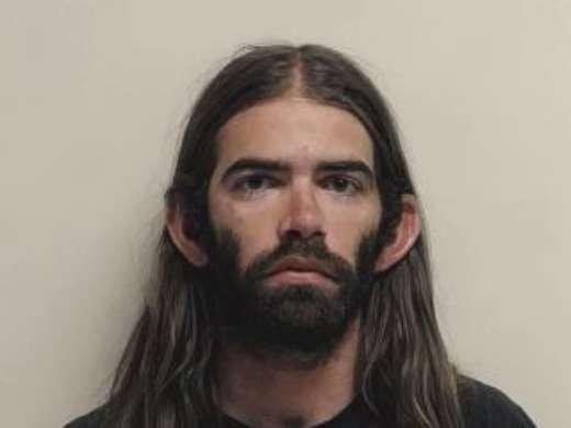 Man attacks stranger's car with machete, threatens to kill him