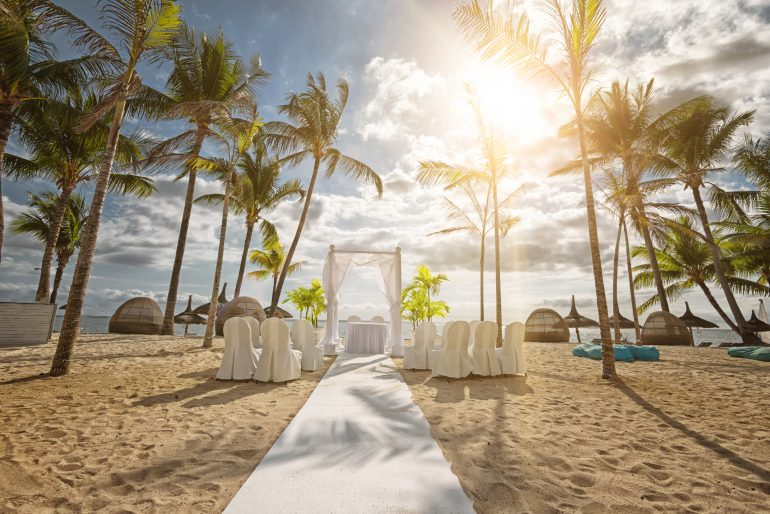 Book your flights early and your hotels later to get the best prices, and don't assume the wedding discount at the hotel is the best rate.