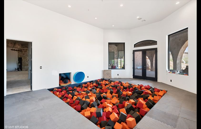 Modern 'castle' comes with ball pit, slides and a climbing wall