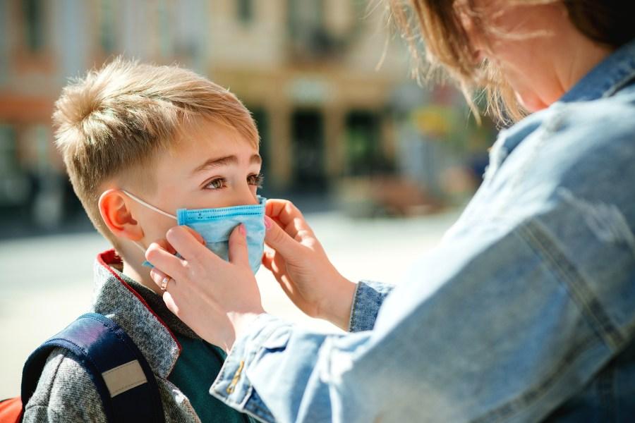 Kid wearing mask to school