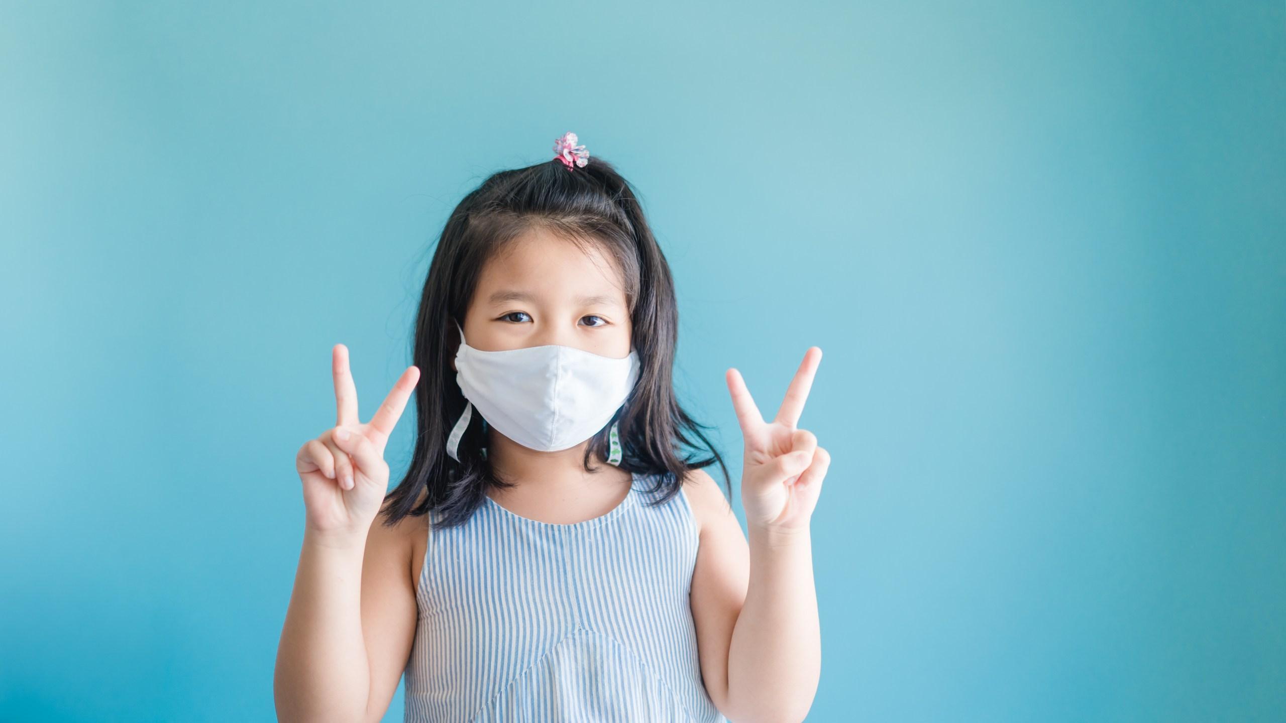 Kid wears mask