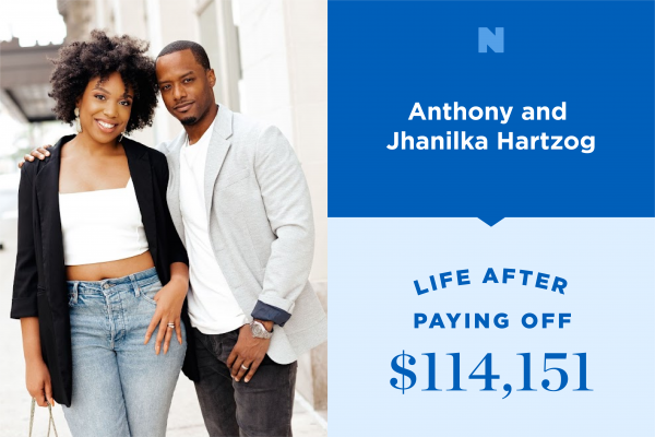 Jhanilka and Anthony Hartzog stand together outside smiling.